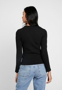 Nly by Nelly - CUT OUT - Long sleeved top - black - 2