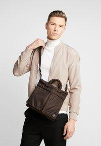 Nexus VII. - PORTER YOSHIDA X NEXUS VII HELMET BAG SMALL - Handbag - brown - 1