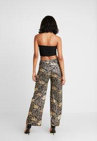NEW girl ORDER - DRAGON WIDE LEG TROUSER - Pantalon classique - black - 2