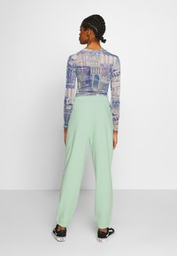 NEW girl ORDER - MIXED ART NUMERAL JOGGER - Tracksuit bottoms - mint - 2