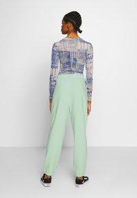 NEW girl ORDER - MIXED ART NUMERAL JOGGER - Teplákové kalhoty - mint - 2
