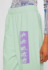 NEW girl ORDER - MIXED ART NUMERAL JOGGER - Teplákové kalhoty - mint - 4