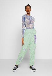 NEW girl ORDER - MIXED ART NUMERAL JOGGER - Teplákové kalhoty - mint - 1