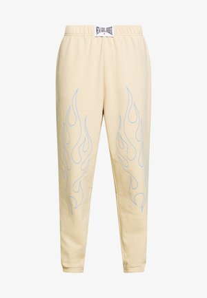 OUTLINE FLAME JOGGERS - Tracksuit bottoms - beige