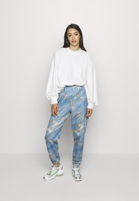 NEW girl ORDER - MARBLE  - Tracksuit bottoms - blue - 1