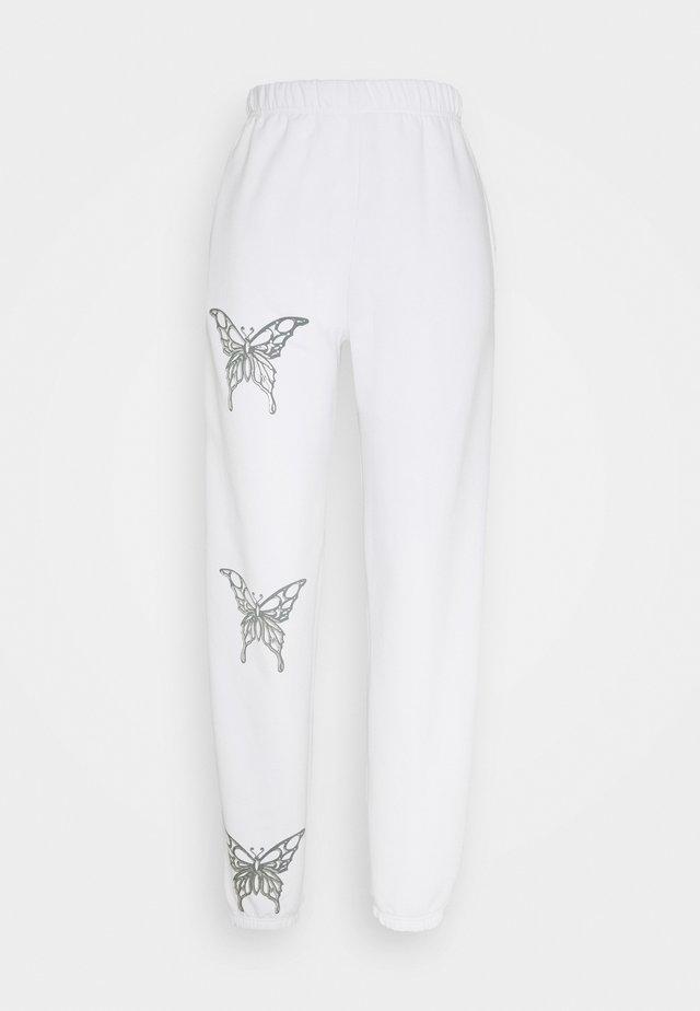 BUTTERFLY JOGGERS - Teplákové kalhoty - white