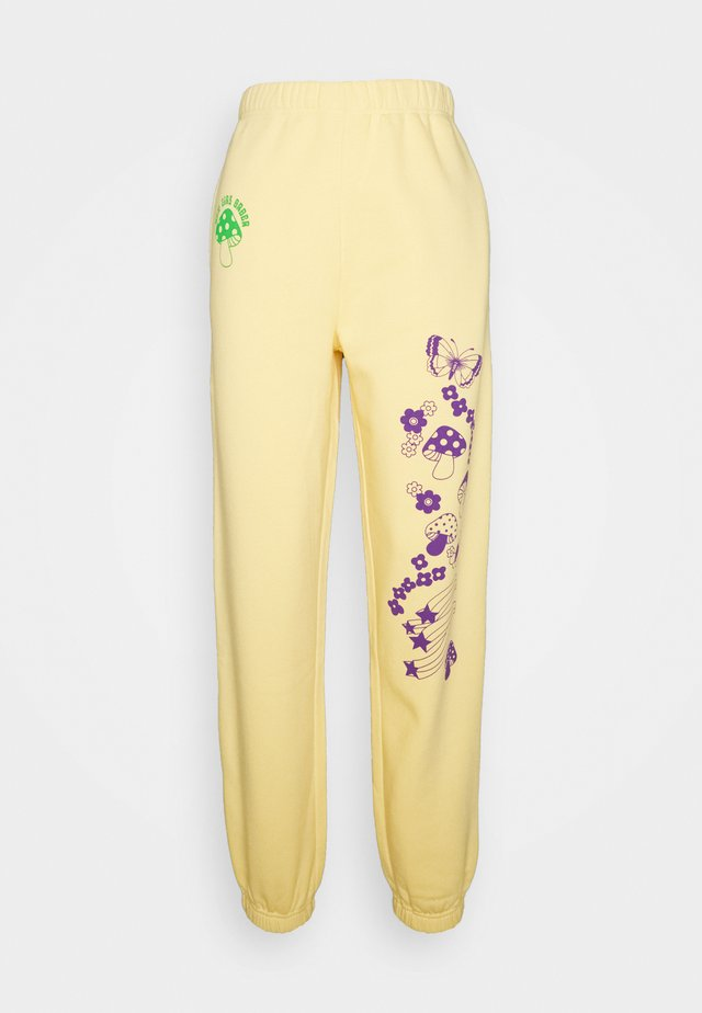 DIVINE INTENTIONS JOGGERS  - Tracksuit bottoms - yellow