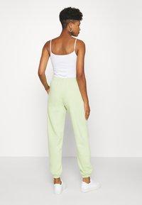 NEW girl ORDER - METALLIC TRIBAL FLAME JOGGERS - Teplákové kalhoty - green - 2