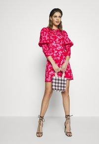 Never Fully Dressed - MINI DELORES DRESS - Korte jurk - pink - 1