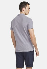 NEW IN TOWN - Polo shirt - grey