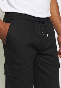Newport Bay Sailing Club - CARTEL - Shorts - black - 4