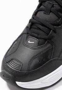 Nike Sportswear - M2K TEKNO - Sneakersy niskie - black/white - 7