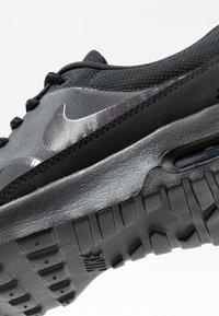Nike Sportswear - AIR MAX THEA - Sneaker low - off noir/gridiron/black/summit white - 2