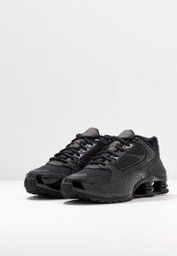 Nike Sportswear - SHOX ENIGMA 9000 - Trainers - black/gym red - 4
