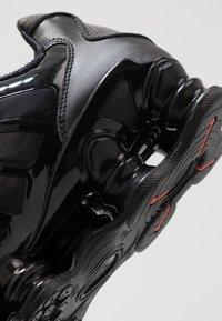 Nike Sportswear - SHOX TL - Sneakers - black/metallic hematite/max orange - 8