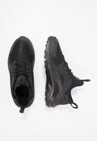 Nike Sportswear - HUARACHE RUN ULTRA (PS) - Sneakers - black - 1