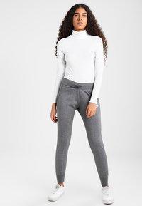 Nike Sportswear - PANT TIGHT - Teplákové kalhoty - charcoal heather/dark grey/white - 1