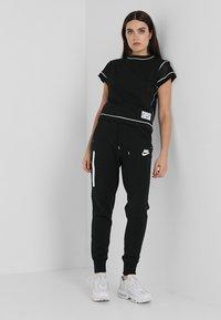 Nike Sportswear - Pantaloni sportivi - black/black/white - 1