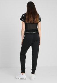Nike Sportswear - Pantaloni sportivi - black/black/white - 2