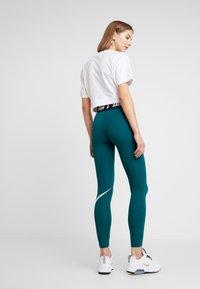 Nike Sportswear - CLUB  - Leggings - midnight turq/white - 2