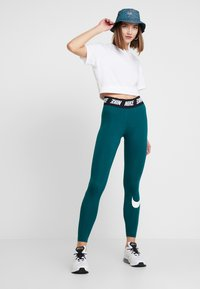 Nike Sportswear - CLUB  - Leggings - Trousers - midnight turq/white - 1