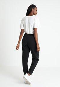 Nike Sportswear - RALLY - Spodnie treningowe - black - 2
