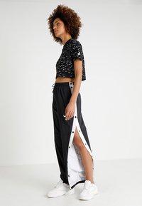 Nike Sportswear - PANT POPPER - Træningsbukser - black/white - 1