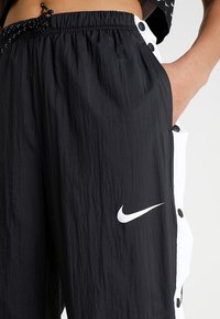 Nike Sportswear - PANT POPPER - Træningsbukser - black/white - 4