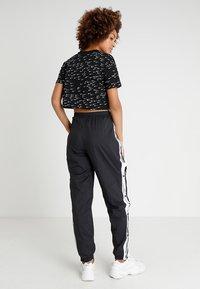 Nike Sportswear - PANT POPPER - Træningsbukser - black/white - 2