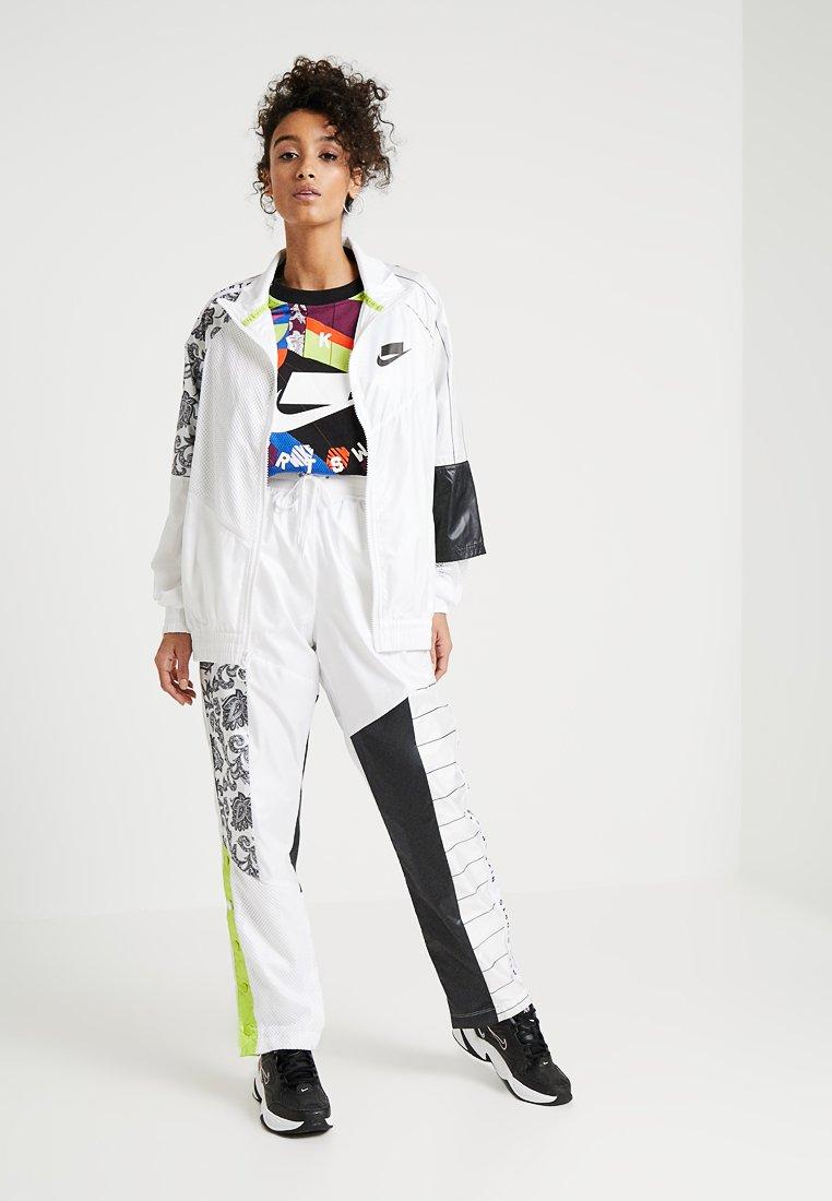 Nike Sportswear PANT - Spodnie treningowe - white/black