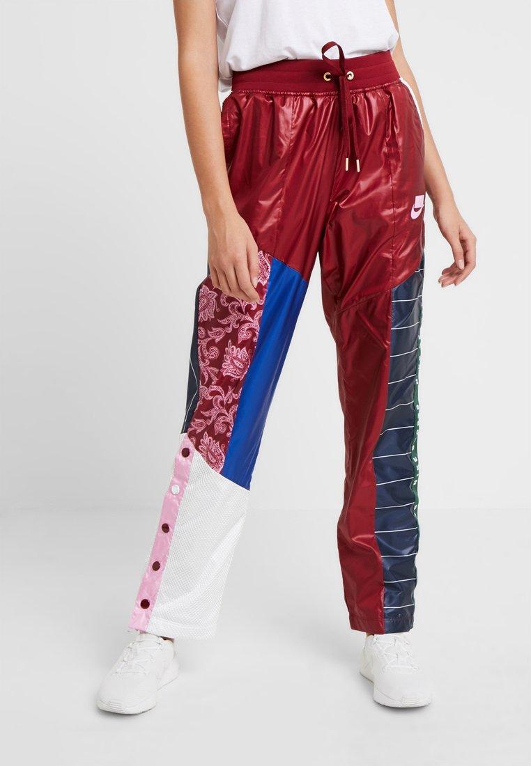 Nike Sportswear - PANT - Träningsbyxor - team red/pink rise