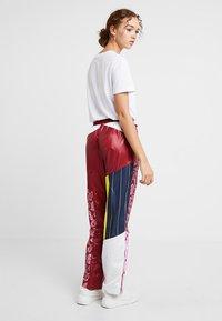 Nike Sportswear - PANT - Träningsbyxor - team red/pink rise - 2