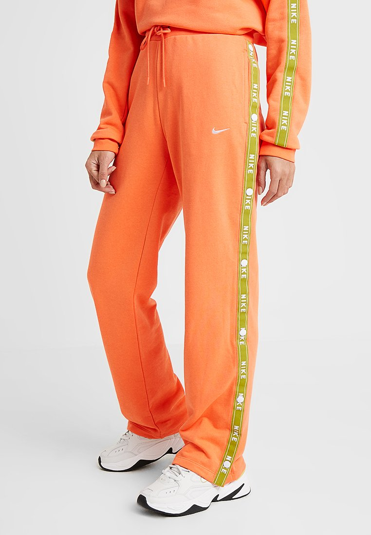 Nike Sportswear - PANT LOGO TAPE POPPER - Træningsbukser - orange