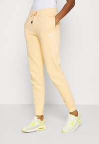 Nike Sportswear - Tracksuit bottoms - orange/chalk - 0