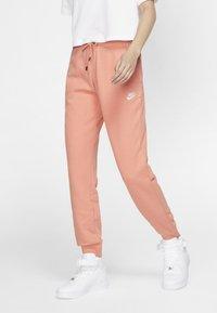 Nike Sportswear - Spodnie treningowe - pink quartz/white - 0