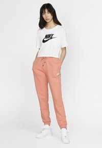 Nike Sportswear - Spodnie treningowe - pink quartz/white - 1
