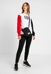 Nike Sportswear - PANT TIGHT - Trainingsbroek - black/white - 1