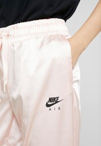 Nike Sportswear - AIR PANT - Pantalon de survêtement - echo pink - 4