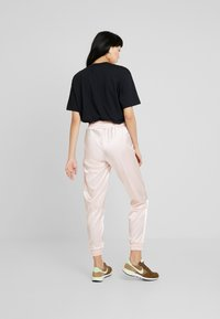 Nike Sportswear - AIR PANT - Pantalon de survêtement - echo pink - 2