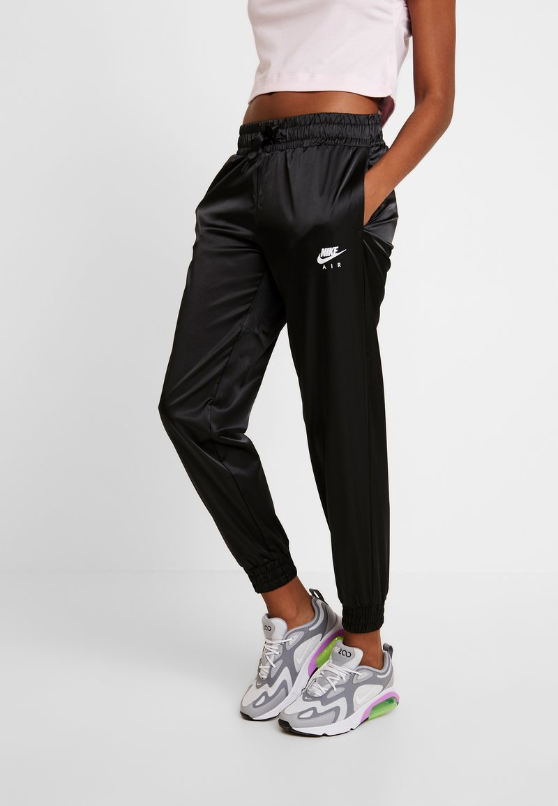 Nike Sportswear - AIR PANT - Tracksuit bottoms - black