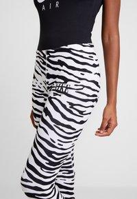 Nike Sportswear - Leggings - Trousers - white/black - 4