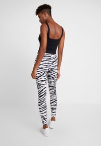 Nike Sportswear - Leggings - white/black - 3
