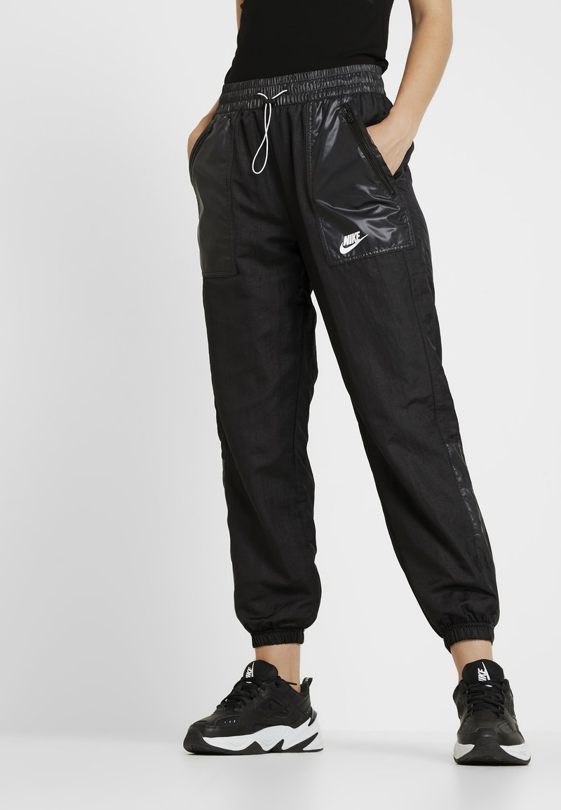 Nike Sportswear - PANT CARGO REBEL - Tracksuit bottoms - black/white
