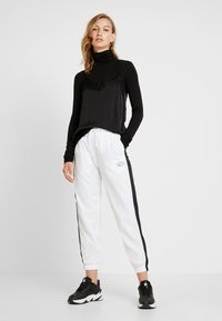 Nike Sportswear - Tracksuit bottoms - white - 1