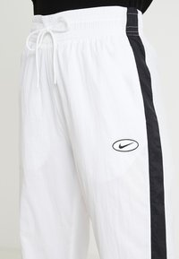 Nike Sportswear - Tracksuit bottoms - white - 4
