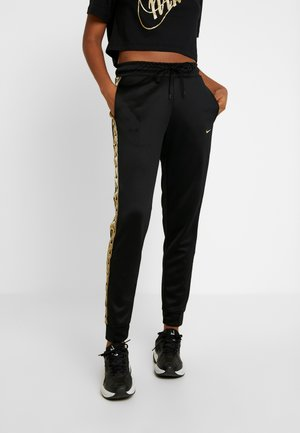 JOGGER LOGO TAPE - Tracksuit bottoms - black/gold