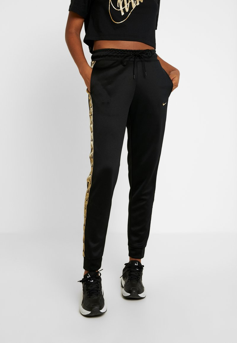 Nike Sportswear - JOGGER LOGO TAPE - Tracksuit bottoms - black/gold