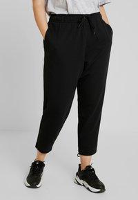 Nike Sportswear - PANT TIE - Verryttelyhousut - black - 0
