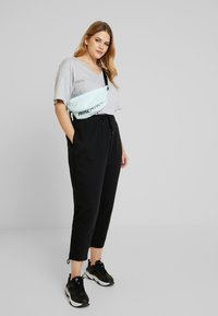 Nike Sportswear - PANT TIE - Verryttelyhousut - black - 1