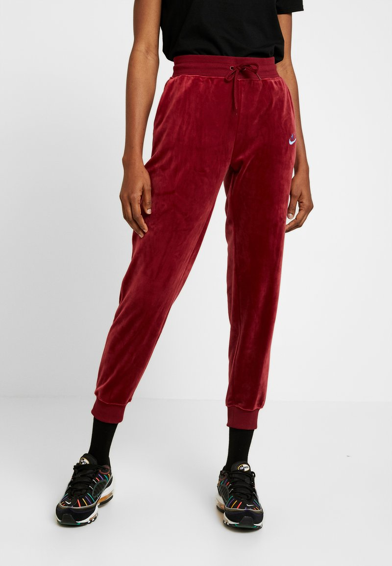 Nike Sportswear - PANT PLUSH - Tracksuit bottoms - team red/university blue